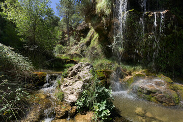 Waterfall in Bogarra province of Albacete Spain. Horizontal shot with natural light.