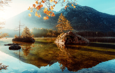 Fotomurales - Sunny Landscape. Mountain Alpine Lake with Hills on Background under Bright Sunline. picturesque autumn scenery. concept of travel vacation. Natural background. Postcard. Instagram Effect. Hintersee.