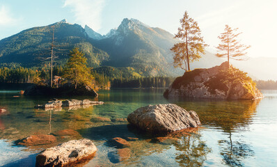 Fotomurales - Sunny Landscape. Mountain Alpine Lake with Hills on Background under Bright Sunline. picturesque autumn scenery. concept of travel vacation. Natural background. Postcard. Instagram Effect. Hintersee
