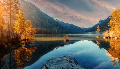 Fotomurales - Wonderful Colorful Sunset at Hintersee Lake in Bavarian Alps. Awesome Alpine Highlands in sunny Day. Amazing Autumn Natural Background. Incredible Nature Landscape. Beautiful locations of the World