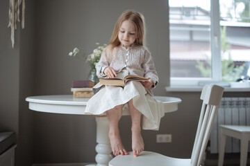 blond girl with long hair reading
