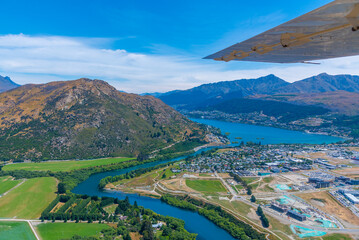 Wall Murals Deep brown Aerial view of Frankton district of Queenstown in New Zealand