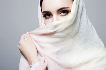 beautiful young woman covered her face. beauty girl in hijab