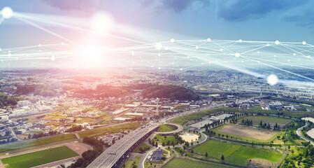 社会とネットワーク 都市の空撮と通信イメージ