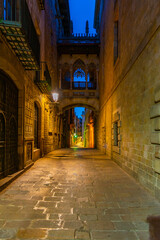 Sunrise view of a narrow street in center in Barcelona, Spain