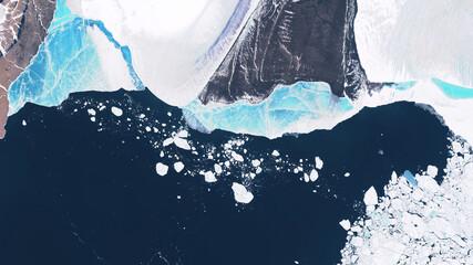 Glacier in Greenland, blocks of ice floating in the ocean, seasonal changes in glaciers.