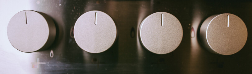 White, black, switch on the electric stove close-up. Closeup Of Knobs Switch Of Gas Stove. oven temperature control closeup. vintage photo processing