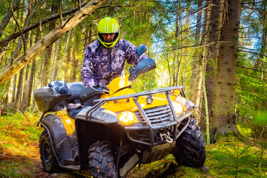 A man in a yellow helmet on the ATV close-up. Riding a Quad bike