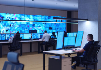 male operator working in a security data system control room