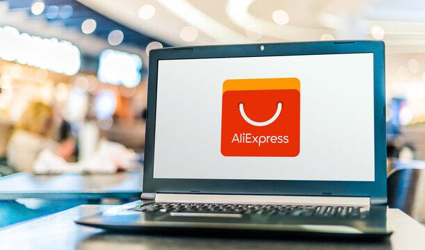 Laptop computer displaying logo of AliExpress