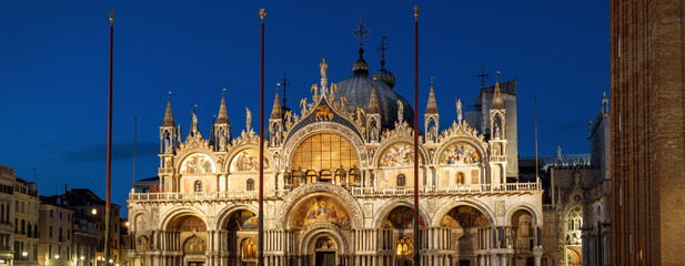 Fototapete - St Mark`s basilica or San Marco at night, Venice, Italy. Medieval basilica is top landmark of Venice. Panoramic view of facade