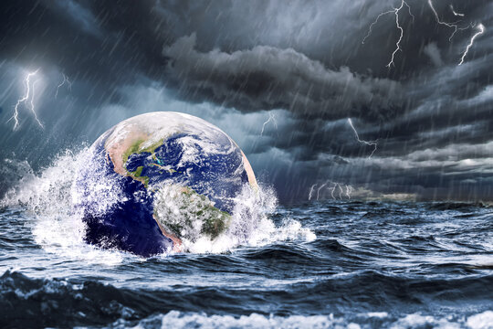 Earth flooded during a sea storm. Extreme weather and climate change concept (Earth photo by NASA)