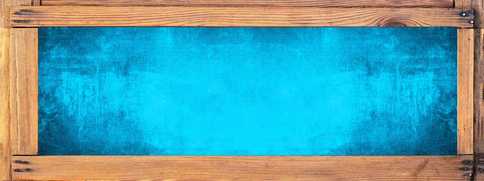 Empty wooden picture frame and blue festive abstract texture background banner, with space for text