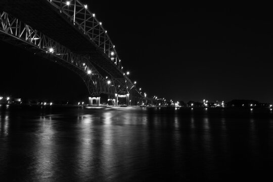 black and white Night image of the Blue Water Bridge from Port Huron crossing over the St. Clare River overlooking Sarnia Ontario Canada