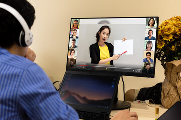 10 people attending online course while teacher writing on white board