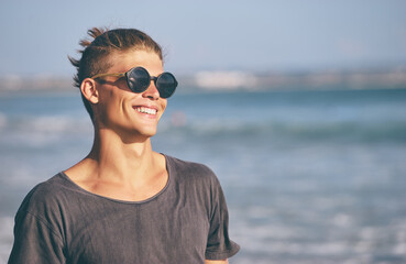 Portrait of young handsome man on the sea shore.