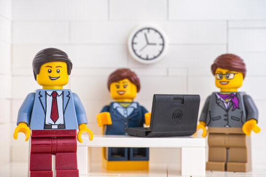 Tambov, Russian Federation - June 3, 2020 Lego minifigure businessmen having a meeting and discussing the results of their successful teamwork.