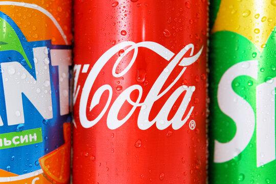 Tyumen, Russia-may 20, 2020: Close-up soda Coca Cola, Fanta, sprite logo close-up in water drops