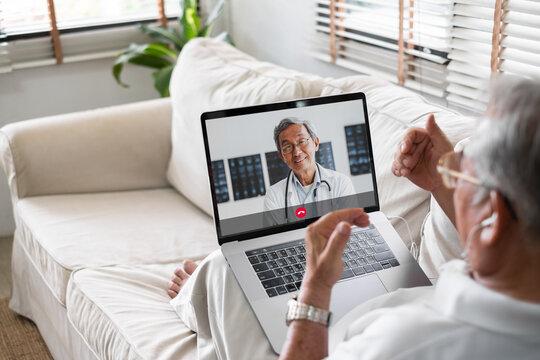 Asian senior video call with doctor telemedicine telehealth concept