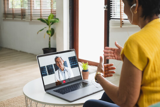 Asian senior video call with doctor telemedicine telehealth concept