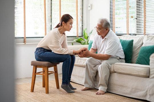 Caregiver psychologist console Asian senior people for mental health
