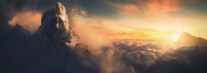 Foto op Plexiglas Cappuccino Beautiful aerial landscape of mountain peak at sunset above the clouds - panoramic