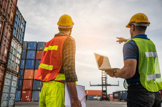 worker teamwork and partner of foreman, engineer, and businessman working in an international shipping area, concept of business industrial and working in container yard