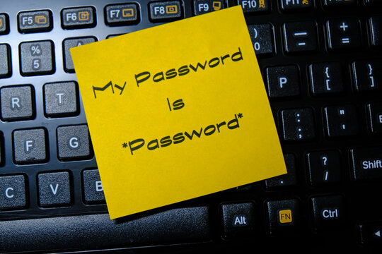 Sticky Note With Weak password. Internet banking, data privacy and cyber security concepts.