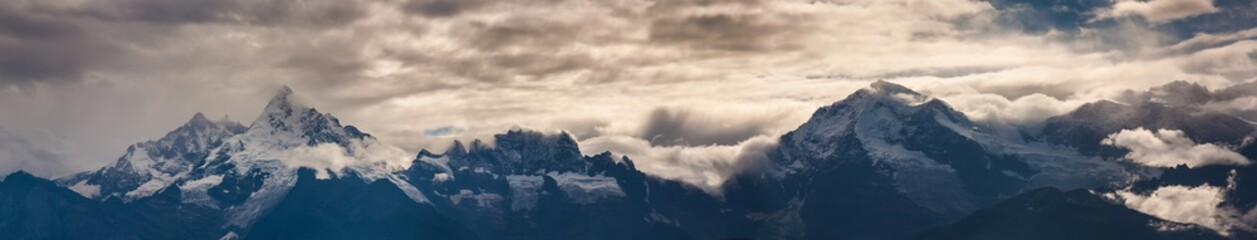 Panoramic shot of rocky mountains under a cloudy sky - perfect for natural concepts