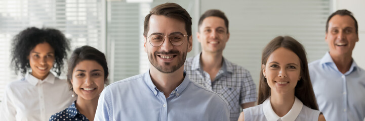 Caucasian boss company owner leader and multi ethnic employees pose for camera. Millennial business people successful staff members portrait concept. Horizontal photo banner for website header design