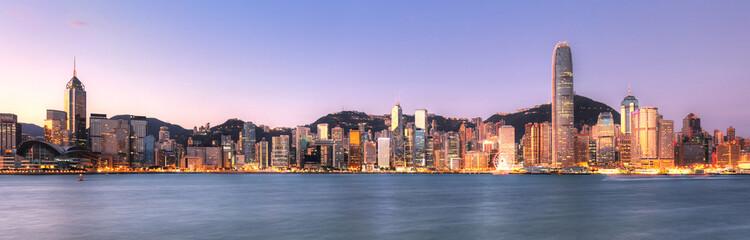 Fotomurales - Victoria Harbor at sunset view in Hong Kong, China