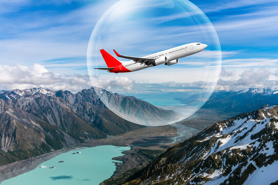 Travel bubble concept - Airplane traveling in bubble representing international travel bubble project to revive tourism and hotel industry among countries that show good control of covid 19 spreading.