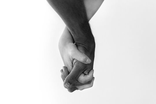 Anti racism and black lives matter. White, black couple holding hands.
