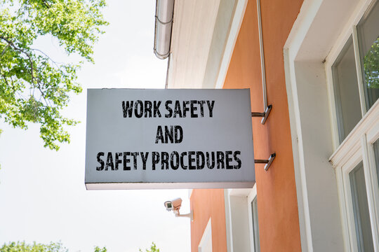 WORK SAFETY AND SAFETY PROCEDURES concept. Advertising banner and security camera