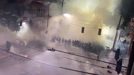 Still image from a video shows smoke filling up a street during a protest against racial inequality in the aftermath of the death in Minneapolis police custody of George Floyd, in Seattle