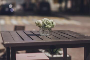 flower bouquet in a vase in cafe.