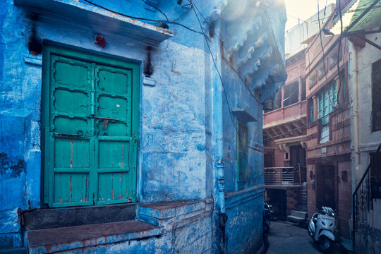 "Blue houses in streets of of Jodhpur, also known as ""Blue City"" due to the vivid blue-painted Brahmin houses, Jodhpur, Rajasthan, India"