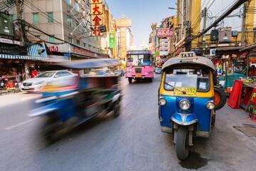 Bangkok, Thailand - April 24, 2016: Tuk-tuk taxi parked near street market in Chinatown on April 24, 2016 in Bangkok, Thailand.
