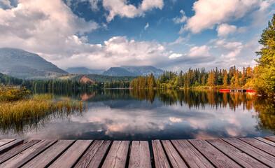 Fotomurales - Splendid Alpine scenery in summer, Colorful sky, Over the Amazing lake Strbske Pleco. Famous is popular Alpine location. Wonderful landscape High Tatra. Nature in springtime. Awesome Autumn Scene.