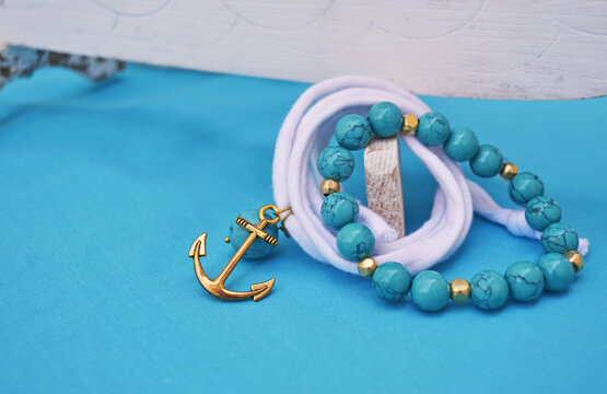 summer jewelry - turquoise gemstone bracelet and gold anchor charm