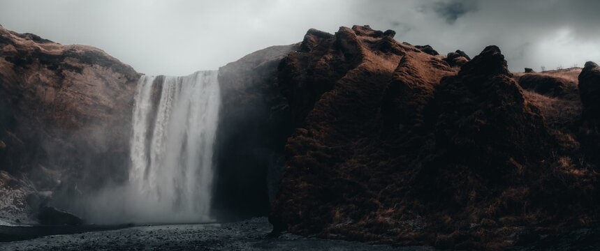 Small waterfall in the rocks on a gloomy ay in Iceland