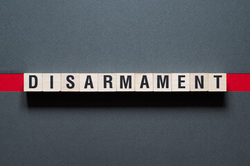 Disarmament word concept on cubes