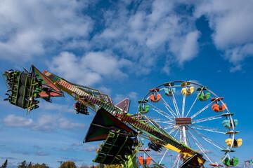 colourful fall fair rides