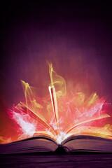 Fototapeta Magic book with light on black background obraz