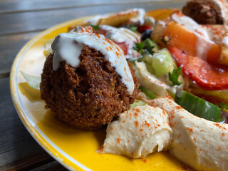 Falafel with hummus and vegetables on a plate