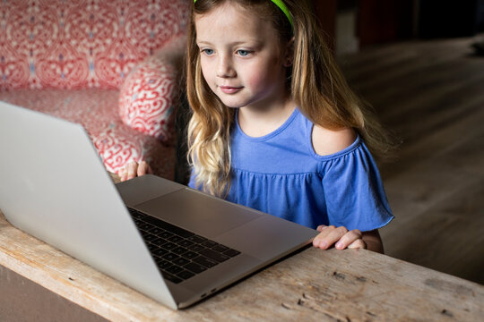 A child using a laptop at home