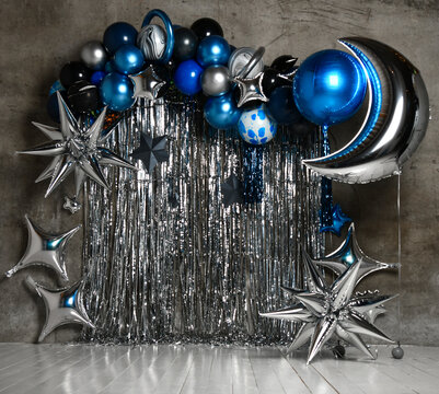 Space balloons photo zone with blue and silver stars for child kids birthday party decor. Holiday decoration