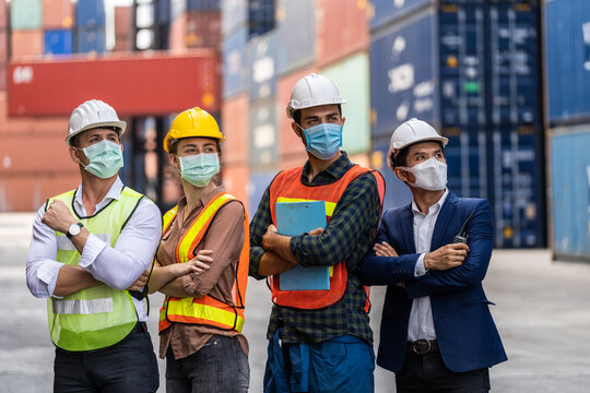 Workers waring surgical mask and safety white head to protect for pollution and virus in workplace during concern about covid pandemic