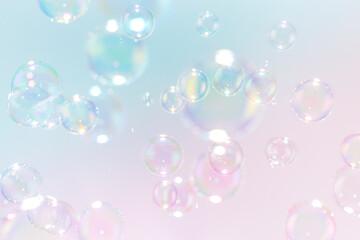 Beautiful rainbow soap bubbles float as background.