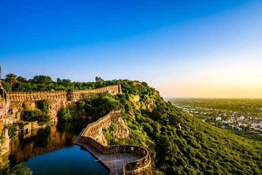 View during sunset from Chittor or Chittorgarh Fort with city in backdrop. It is one of the largest forts in India &  listed in the UNESCO World Heritage Sites list as Hill Forts of Rajasthan.